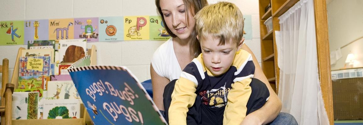 student teacher reading to child