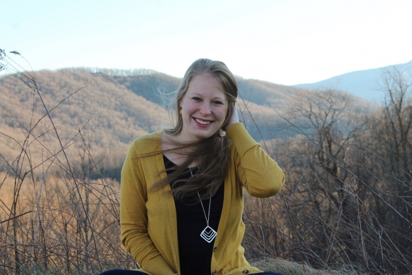 Jessica Rocklein sitting in the mountains