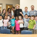 Chancellor stands with students of middle fork academy